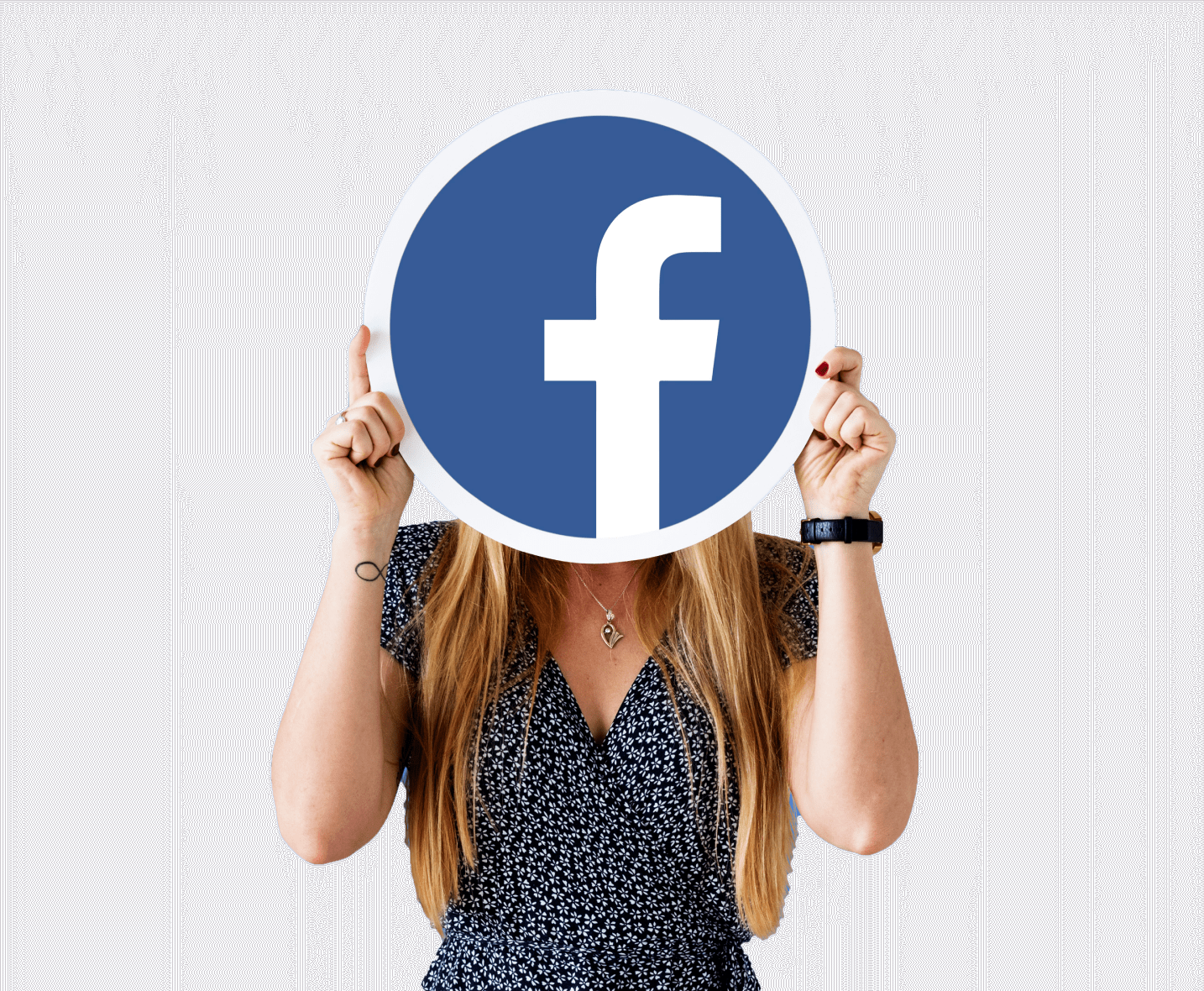 Woman holding the Facebook logo in front of her face